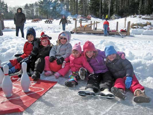 Bolton-area youngsters take a break after ice skating at Bolton's Winter Break Party on Saturday, Feb. 23. The event, held at the Bolton Conservation Club, featured an array of winter outdoor activities.