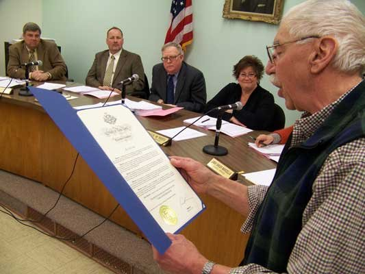 At the Feb. 13 Warrensburg town board meeting, town museum director Steve Parisi reads a proclamation issued by Gov. Andrew Cuomo heralding Warrensburgs bicentennial.
