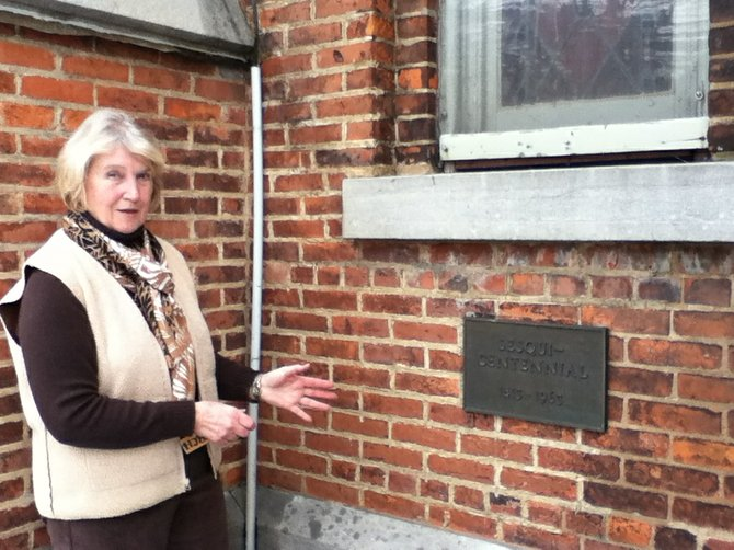 Luella Oakes shows where a 50-year-old time capsule was recovered from the outer wall of the First Presbyterian Church on Jan. 13.