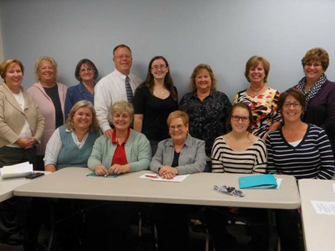 The Baldwinsville Volunteer Center Board of Directors include (standing, from left) Kathy Dengler, Audrey Jones, Barb Presley, Jim Honsinger, Emily Ekross, Nancy Conley, Maureen Fleming, Bonny McCabe (seated, from left) Megan O'Donnell, Elaine Gagas, Janet Therrien, Grace Santoro and Lauri Bernstein. Mike Shepard and Andrea Gagas are missing from the picture.