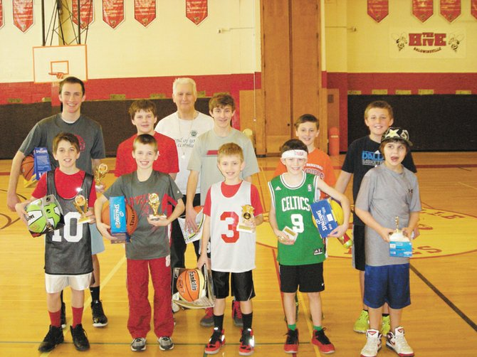 Baldwinsville Optimist Donald Varn stands behind the March 9 Baldwinsville Optimist Club Foul Shooting Contest winners (front row, from left) Ryan Fecco, Michael Carr, Ben Bifulco, Colin Delaney, Jaden White (first through fifth place, respectively, in the less than five feet tall category), (second row, from left) Liam Wicks, Johnathan Bausch, Michael Brossel, Jacob Way and Cole Zsemlye (first through fifth place, respectively, in the five feet or taller category).