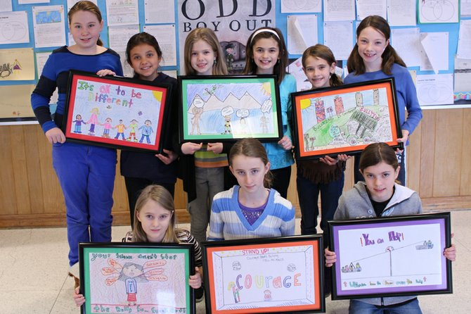 (Back row, from left) Mary Young, Emma Gebhardt, Megan O'Shea, Madison Murphy, Ella Smith, Morgan Hey, (front row, from left) Amanda Huber, Anna Conklin and Hannah Johnson are among the winners of McNamara Elementary School's anti-bullying poster contest. Brooke Arnold is missing from the photo.