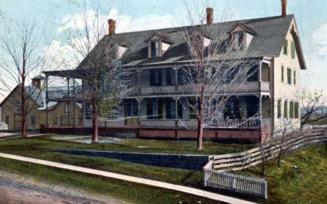 The Straight House, as depicted in this tinted postcard circa 1908, stood on the property until it burned in 1920.