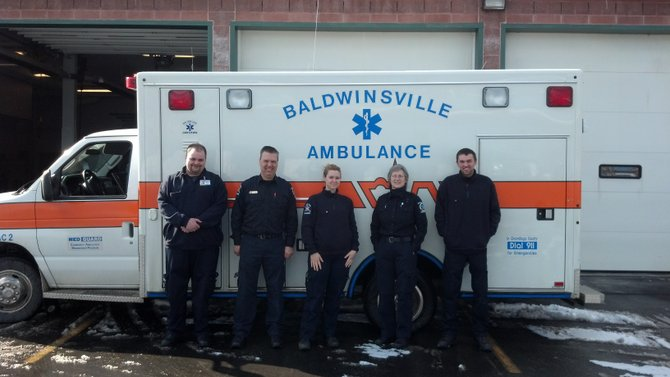 (From left) Adam Arvidson (EMT-P), Jim Hogan (EMT-P, Director), Jillian Golwitzer-Cullen (EMT-P), Kym Shackleton and Zach Roberts (EMT) stand with a Greater Baldwinsville Ambulance Corps ambulance. The local organization is in need of a new ambulance, which costs approximately $120,000.