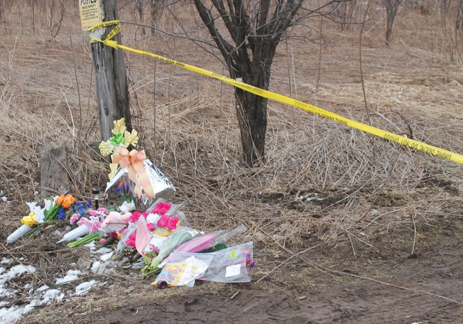 Mourners have placed flowers and notes at a roadside memorial for Lori Bresnahan on VerPlank Road. Bresnahan, a Liverpool Central School District librarian, was killed last week.