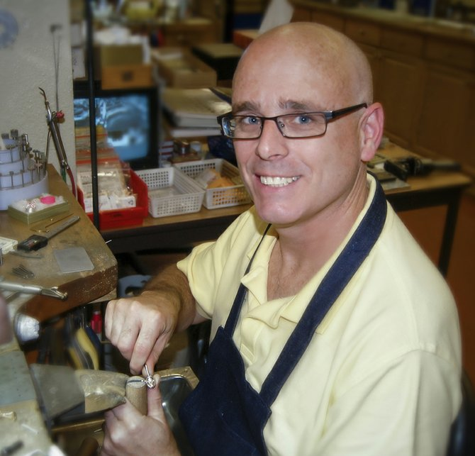 Tom McLaughlin of Lennon Jewelers in Clay works on a piece for his autism collection.