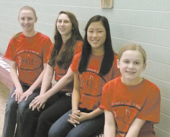 Baldwinsville Sharks Swim Club members (from right) Summer McClintic, Grace Smith, Allie Conner and Brooke Atkinson are four of five girls to recently achieve gold times enabling them to recently compete in a gold meet in Buffalo along with their teammate Sammy.