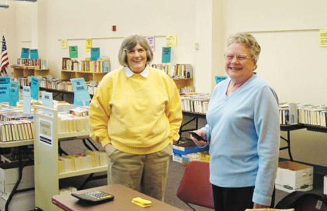 Barb Aitken, President of the Board of Directors of Baldwinsville Public Library, and Leslie Morelli, a Friend of the Library who spearheads the Book Sale Volunteers.