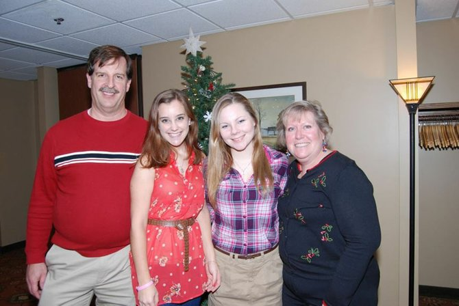Bill, left, and Lynn, right, Rosentels enjoy the Baldwinsville Rotary Club's holiday party with two exchange students Lu Zaya (second from left), of Argentina, and Reetta Lindberg, of Finland.