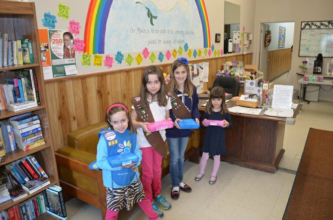 (From left) Anne DeMarco, Emily DeMarco, Madison MacArthur and Megan DeMarco, representatives of Girl Scout Troop 10633 from Palmer Elementary School, stop for a photo op during their April 17 visit to PEACE Inc. in Baldwinsville.