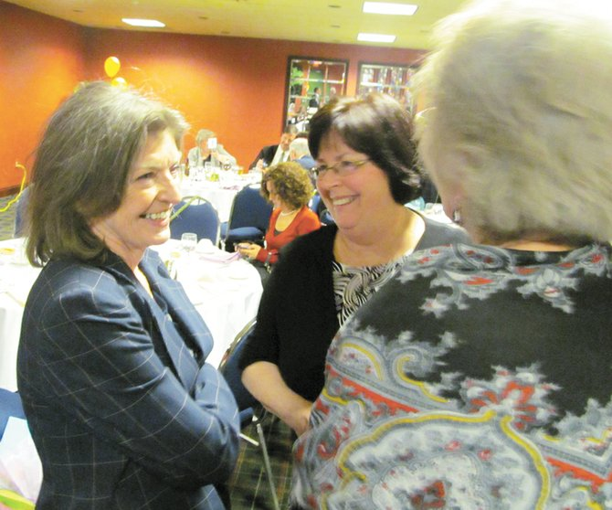 Dawn Custer, left, accepts congratulations for being recognized as the 2012 Woman Volunteer of the Year.