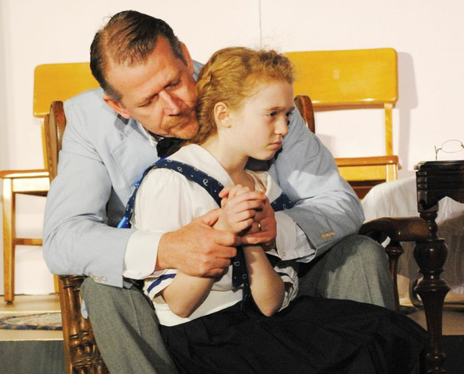 "Sophie Greene, of Baldwinsville, as Helen and Peter Mahan as Captain Keller star in the CNY Arts Center production of ""Helen Keller,"" which will be shown at 8 p.m. May 3 and 4 and at 2 p.m. May 5 at the Methodist Church, 357 State St., Fulton. For tickets, visit cnyartscenter.com."