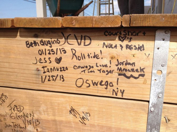 The walls inside Reisie Murchison's new home in Arabi, La., are filled with the signatures of Operation Southern Comfort volunteers who built the structure.