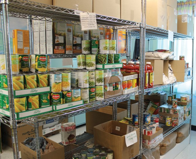 The Brewerton Food Pantry, a joint effort of four area churches, offers clients the ability to choose their own foods within certain nutritional guidelines.