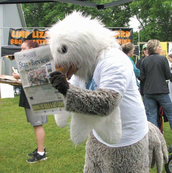 The Eagle Newspapers mascot checks out a copy of the Star-Review at last year's Cicero Community Festival. This year's event is this weekend.