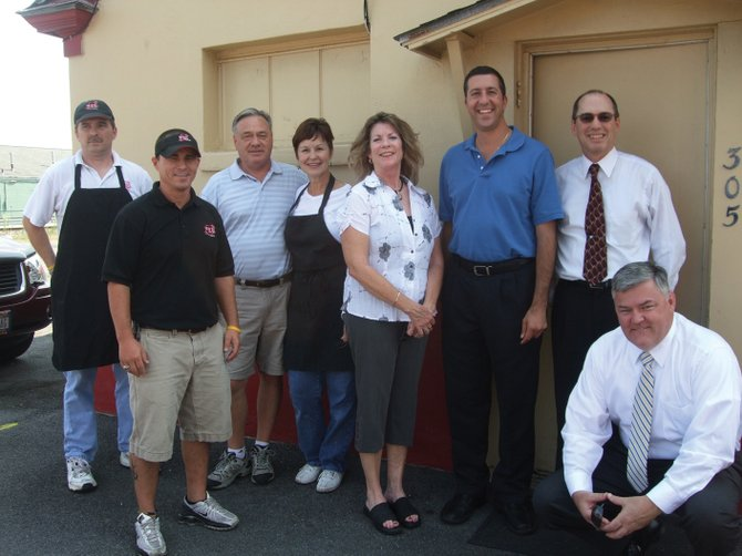 Pictured from left are two unidentified Heid's employees, Heid's owner John Parker, his wife Sandy Parker, Fourth District Onondaga County Legislator Judy Tassone, Salina Supervisor Mark Nicotra, Past President of the Liverpool Chamber William Pastella and former Liverpool Chamber board member Ted Carr. John Parker passed away last week.