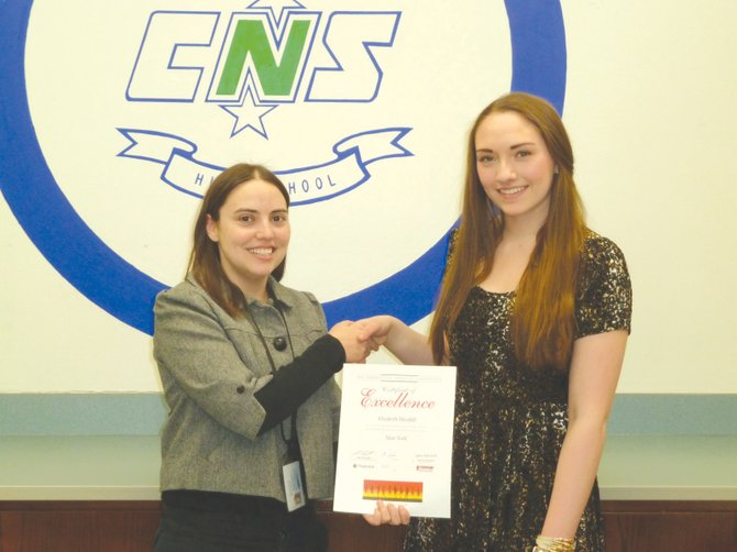 Elizabeth Westfall was recently honored for her volunteer efforts with a Certificate of Excellence from the Prudential Spirit of Community Awards, as well as a President' Volunteer Service Award. She is pictured here with Cicero-North Syracuse High School Executive Principal Melissa Julian.