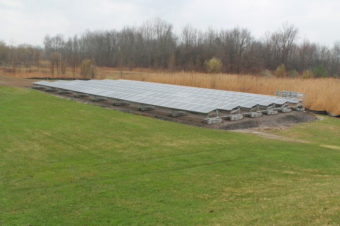 A new 99kw solar array was unveiled behind Clay Town Hall last week. The array will generate an energy savings of approximately $16,000 a year, according to Supervisor Damian Ulatowski.