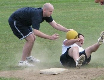 Ryan Emery of Mattydale tags out Charlie Coville of Liverpool at last year's Dream Factory kickball tournament.