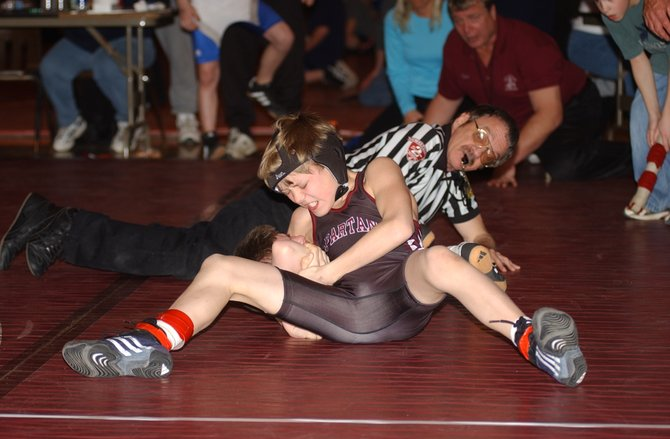 Ian Blatnick squeezes for the win during the Spartan Wrestling Tournament.
