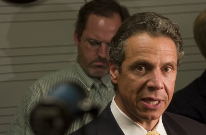 Gov. Cuomo meets with the press after announcing members of the Capital Region Regional Economic Development Council at Schenectady County Community College on Thursday, July 28.