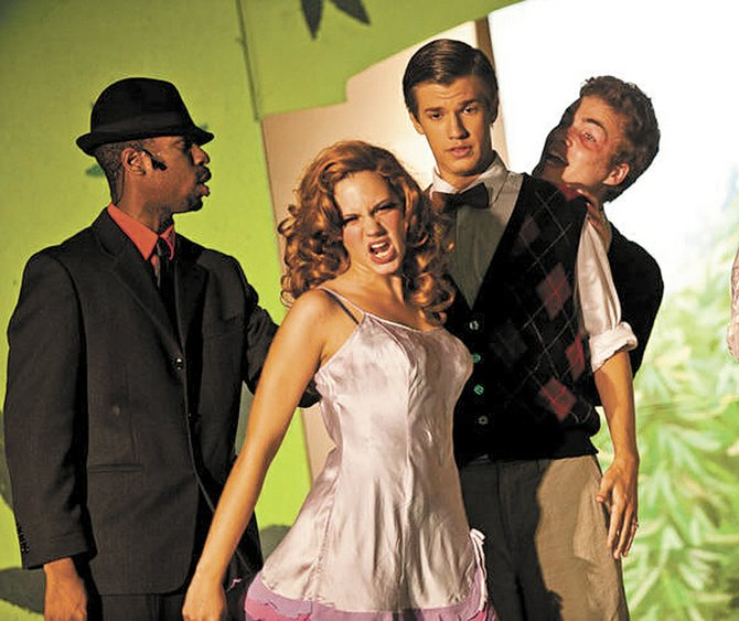 """Jennifer Menter knocks 'em out as fiery redheaded bombshell """"Sally,"""" in Not Another Theater Company's staging of """"Reefer Madness,"""" showing Thursday through Sunday at The Locker Room."""