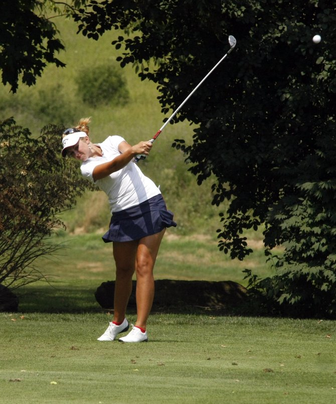 Kathleen Ekey hits an approach shot in last Sunday's final round of the LPGA Futures Tour's Alliance Bank Golf Classic at Drumlins Country Club's East Course. Ekey won by three shots over Jenny Suh with an eight-under-par 205.