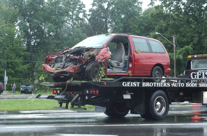 A minivan is carted away from the scene of a four-car crash on the Delmar Bypass on Monday, Aug. 15. Six were injured in the crash and five were hospitalized.