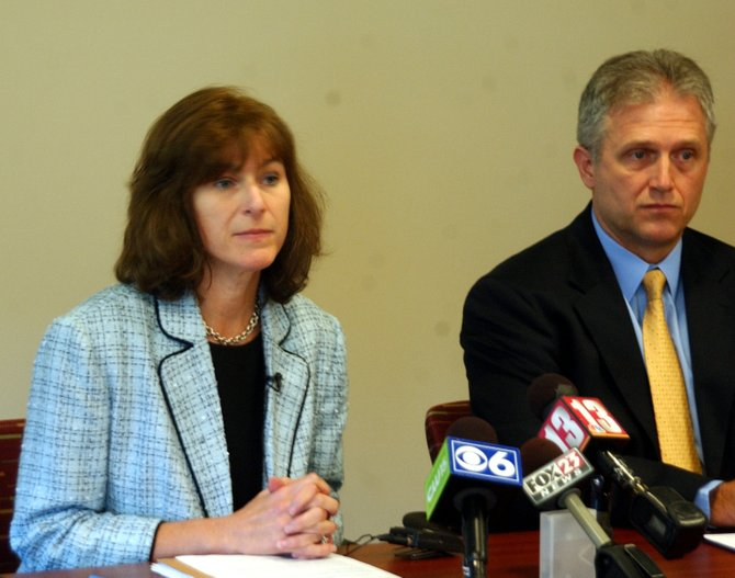 Guilderland Central School District Superintendent Marie Wiles, left, and Guilderland High School Principal Thomas Lutsic discuss scoring errors found on 504 Regents exams administered in June. Human error was attributed for skewing nearly one-in-six of the scores.