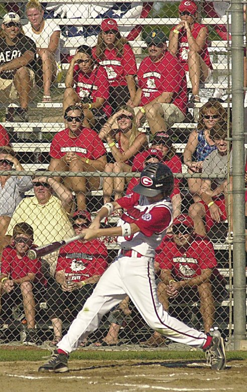 Guilderland's red-clad fans watch Jack Grabek take a swing during Saturday's pool play game against Glen Allen (Va.) at the Babe Ruth World Series in Clifton Park. Rob Jonas/Spotlight
