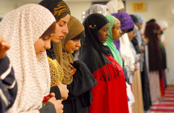 Women pray during the maghrib salah, the fourth prayer of the day, after sunset on Aug. 17 at the Islamic Society of Central New York.