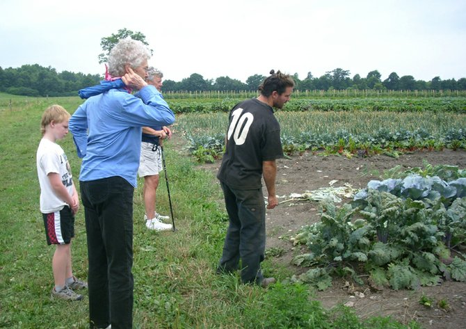 Matt Volz, right, shows a group of curious Cazenovians around Greyrock Farm's vegetable fields on Aug. 6. The trip was sponsored by the Cazenovia Preservation Foundation, as part of their Summer Walk Series.