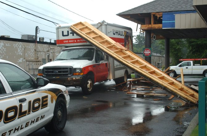 A U-Haul truck didn't quite make it under the drive-thru overhang at Pioneer Bank near Delaware Plaza n Bethlehem on Thursday, Aug. 25.