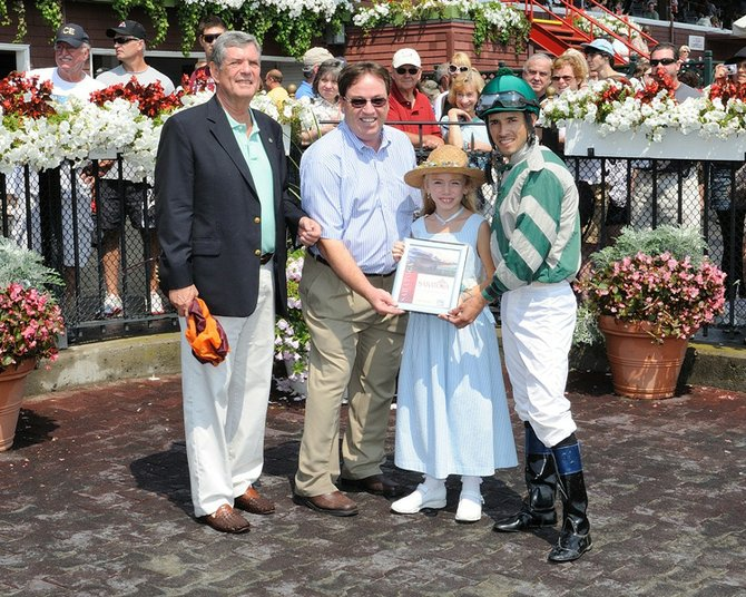 Alayna Gray, 7, of Johnstown, won the first poster contest during the Saratoga Race Course Open House in July.