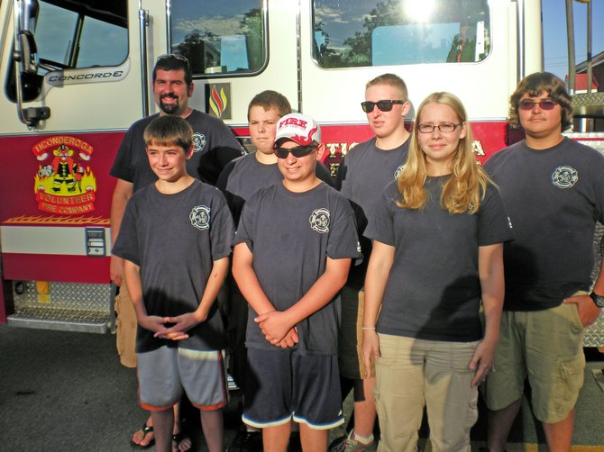 Members of the Ticonderoga Fire Department youth program participate in drills each week with firefighters. Pictured are, front from left, Dillon Crowe, William Gonyo, Samantha Sommerville; back, Chris Stonitsch, adviser, Michael watts, Zech Yaw and Cody Shaner.