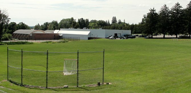 The open parcel of land behind Cazenovia College's Schneeweiss Athletic Complex will soon include a synthetic turf field. Following three Cazenovia Village Planning Board public hearings, the college's request for construction was approved, on the terms they include an enhanced drainage system and exclude lights, seating and extra parking.