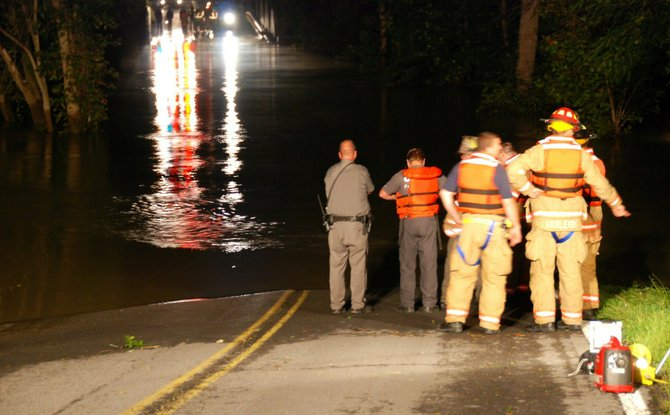 A motorist drove his car into the swollen Normanskill in the early morning of Monday, Aug. 29. The man and his female passenger were stranded in a tree for hours until a nearby resident heard their cries.