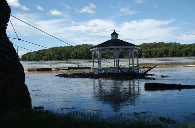 A gazebo at 222 Forts Ferry Road is submerged in water due to rising water levels from the Mohawk River on Monday, Aug. 29.