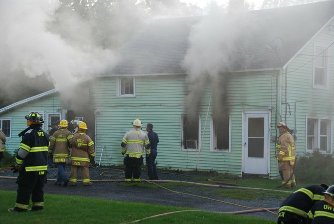 Firefighters battle a blaze at a house on Youmans Road in New Scotland Tuesday, Aug. 30. The fire was ruled an arson and the result of a domestic dispute. Police arrested the homeowner.