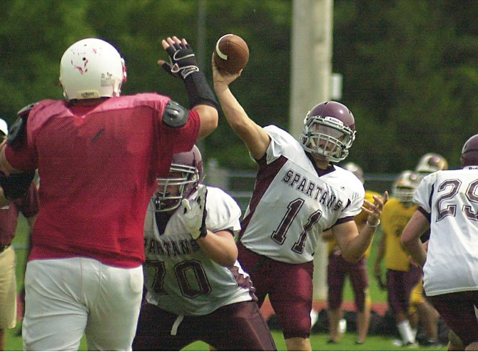 Burnt Hills-Ballston Lake quarterback Ryan McDonnell finds a gap to throw through during last Saturday's multi-team scrimmage at Guilderland High School.