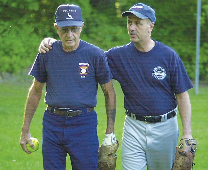 """Clarence """"Khaki,"""" left, and Bob Markel talk strategy prior to last Tuesday's Cooper-Varney Ecumenical Church League softball game in Delmar."""