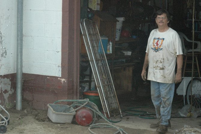 Tim Monaco looks to clean out his store in Upper Jay.