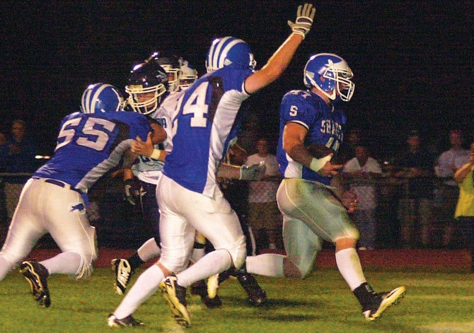 Shaker's Ryan Griffin, right, enters the end zone untouched for a third-quarter touchdown in last Friday's home opener against Columbia. The Blue Bison rallied for a 32-28 victory over the Blue Devils.