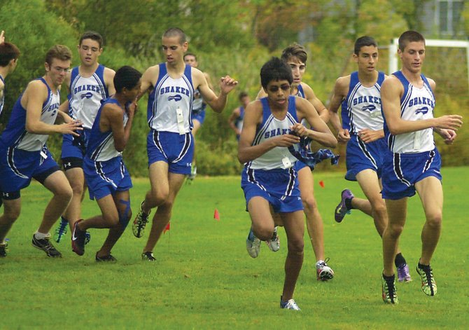 The Shaker boys cross country team executes the sash exchange during last Saturday's Ekiden meet in Niskayuna. The relay race consists of teams of three runners tackling a 1.5-mile loop.