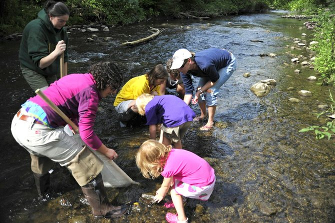 Luca Neugebauer, left, demonstrates how to properly harvest macroinvertebrates from Chittenango Creek, with young Cazenovia residents on Aug. 13. The nature walk was sponsored by the Cazenovia Preservation Foundation, one more excursion will be offered this summer, on Sept. 10.