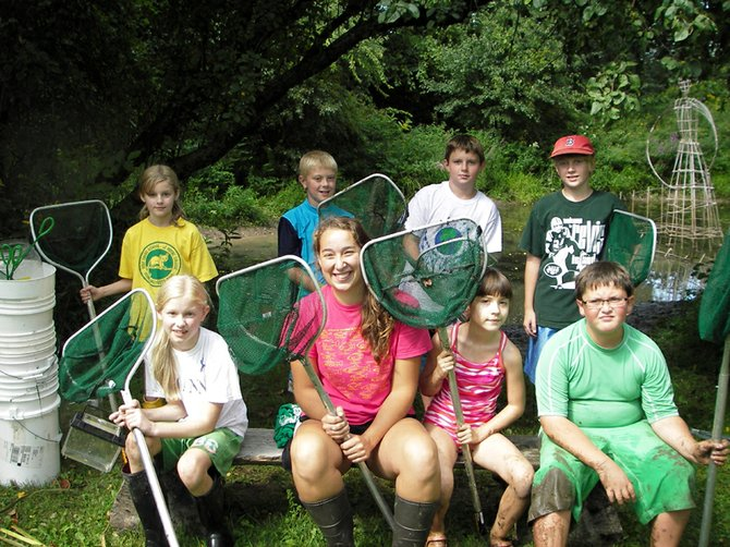The Creatures of the Shallows students: Savannah Conway, left back row, Keegan Bailey, Tim Burr, Eric Ketcham and Brianna Conway, left front row, Renee Adams, Kate Martellock and Chris Hale relax after a fun-filled day of searching for small organisms that inhabit area waters.