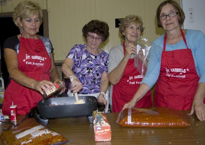 Volunteers cook up some food for St. Gabriel's Fall Festival in Rotterdam on the weekend of Sept. 16 to 18.