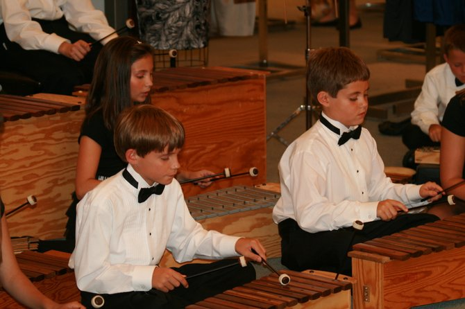 Students playing Orff instruments, named after German Composer Carl Orff, during one of their many performances throughout the year.
