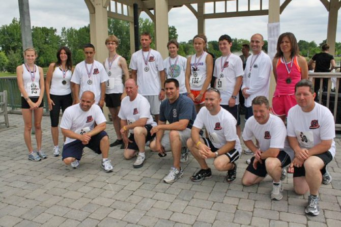 Organizers at participants at last year's Emergency Services 5k Run/Walk where around 250 showed up to run or walk around the Crossings of Colonie Park. Around $10,000 was raised and event organizers hope to match that this year.