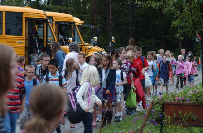 Eagle Elementary School students step off the bus on the first day of the 2011-12 school year for the Bethlehem Central School District.